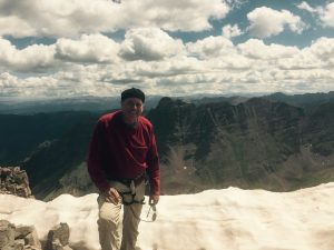 Image of a climber, Rick Minogue, View, from Summit of South Maroon Peak